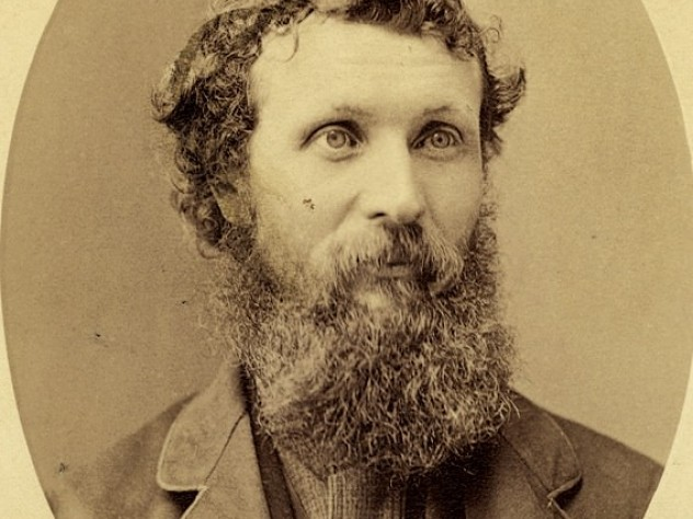A formal portrait of Muir circa 1875