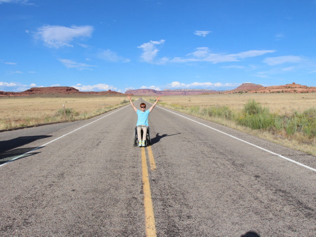 Kunho Kim celebrating on a deserted road in Canyonlands National Park, Utah