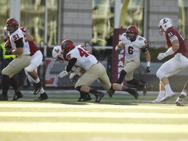 Harvard senior linebacker Eric Medes (49) had a team-high seven tackles and a sack of Leopard quarterback Drew Reed.
