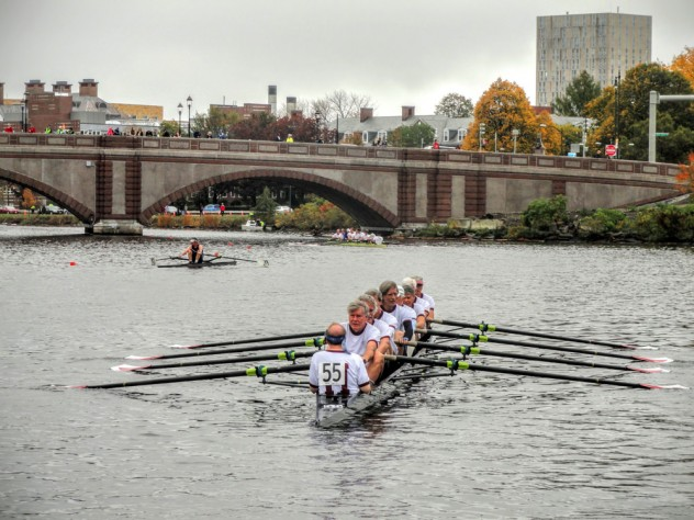 With Olmsted at stroke, the rowers set out from Newell Boathouse toward the starting line.