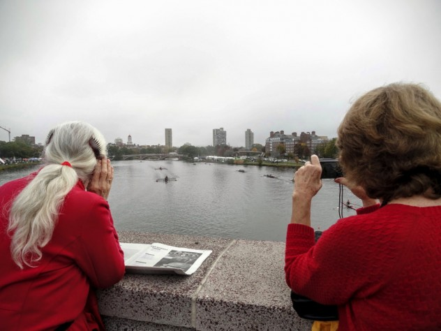 Julie Tonks, camera at the ready, and Abbie Bingham Endicott scan the river for their husbands' boat.