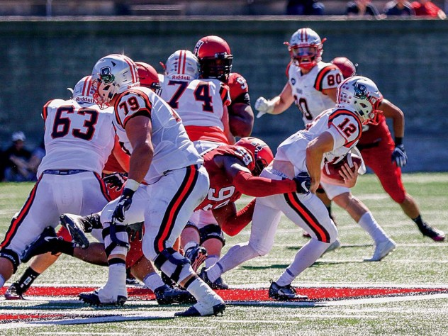 Junior defensive end DJ Bailey (99) registered one of five Harvard sacks against Brown quarterback Nick Duncan.