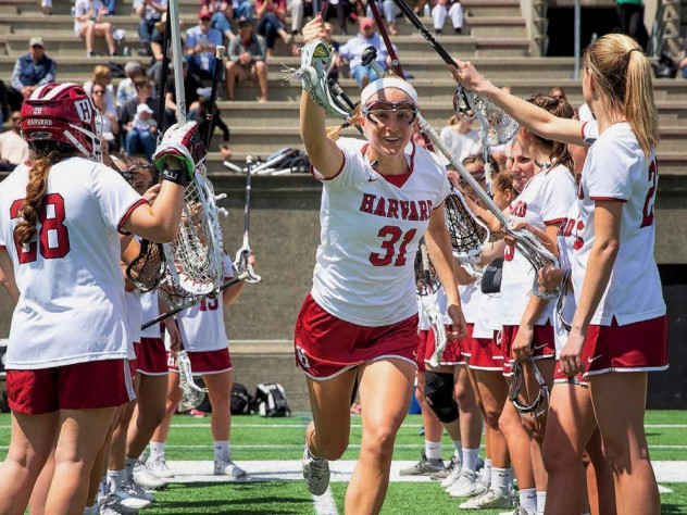 The Harvard women's lacrosse team takes the field.