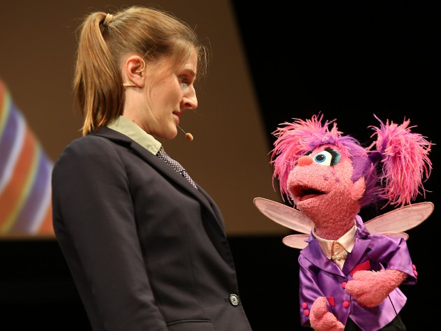 Muppet Abby Cadabby sings with a member of Hasty Pudding Theatricals.