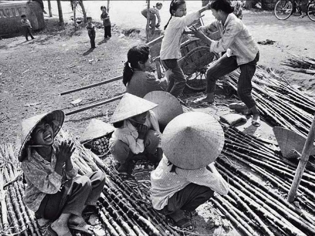 "Black and white photo of street vendors, titled ""Sugarcane Mongers"""