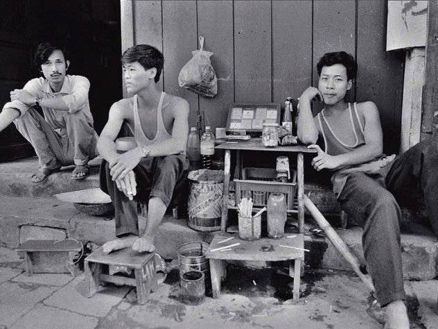 "Black and white photo, titled ""Three Tobacconists"""