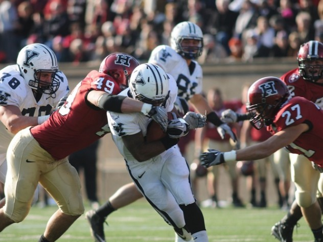 Linebacker Alex Gedeon '12, who will captain the 2011 squad, was credited with seven solo tackles and 10 assists against Yale. Above: with Collin Zych closing in, Gedeon (49) stops halfback Cargill after a first-half gain of four yards.