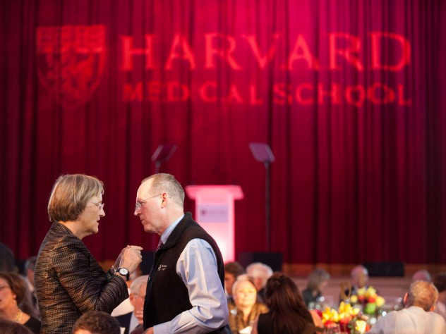President Drew Faust confers with Kolokotrones University Professor Paul Farmer
