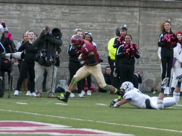 """The play that made """"slant and go"""" part of Crimson lore: Having put a double move on Yale's Dale Harris, Andrew Fischer '16 capered into the end zone after catching the winning pass from Scott Hempel with 55 seconds left."""