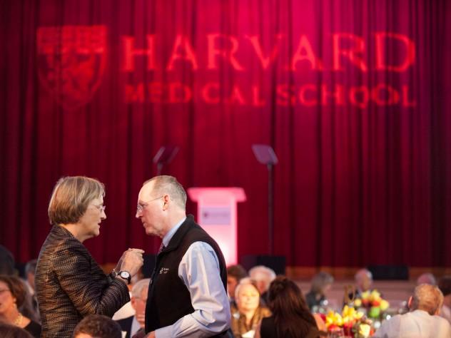 President Drew Faust confers with Kolokotrones University Professor Paul Farmer