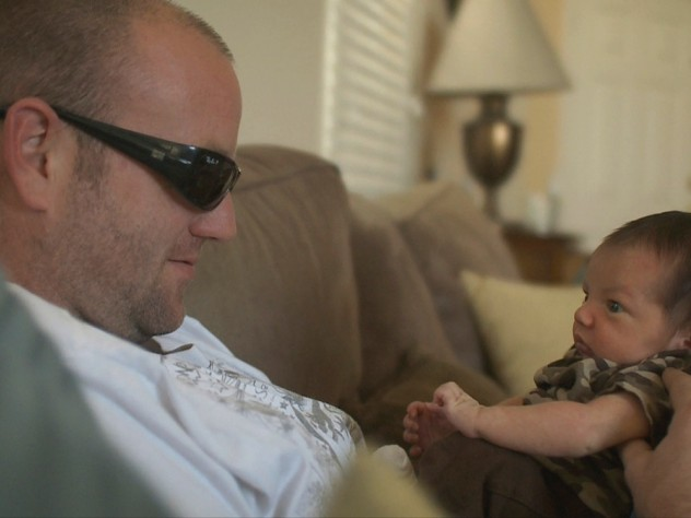 One of the veterans, home from Pathway, cares for his newborn.