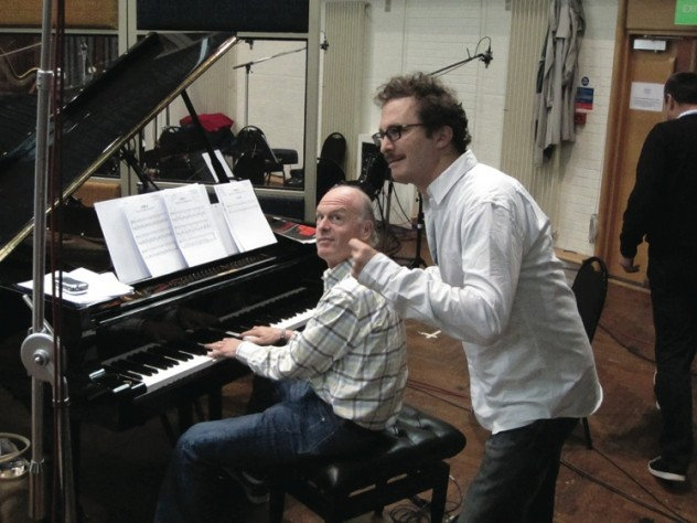Fox Music president Robert Kraft, at the piano, works with film director Darren Aronofsky.
