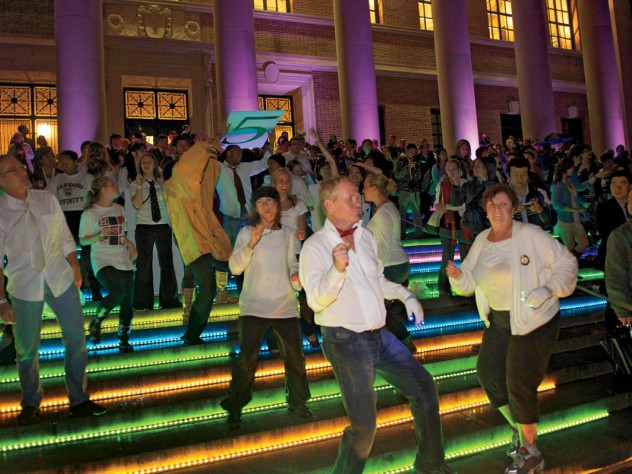 """Kicking up their heels: a """"flash mob"""" started off the evening's dancing with a choreographed routine to the tune of James Brown's """"Papa's Got a Brand New Bag."""""""