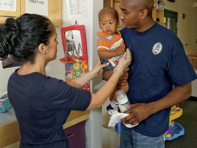 In Dorchester, Amos Monteiro leaves his son, Desmond, with teacher Stella Ortiz.