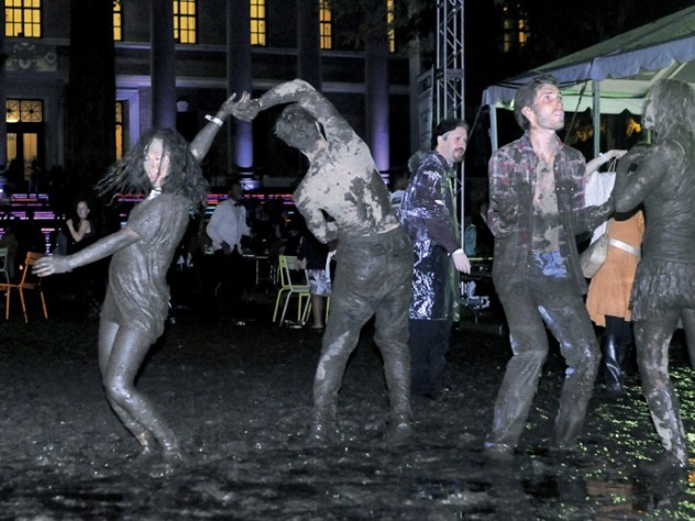 While most revelers fought to keep their feet dry, some embraced the mud.