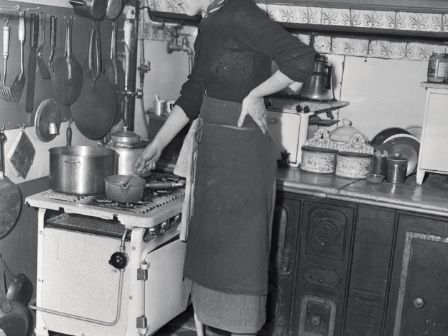 Child in her postwar Paris kitchen