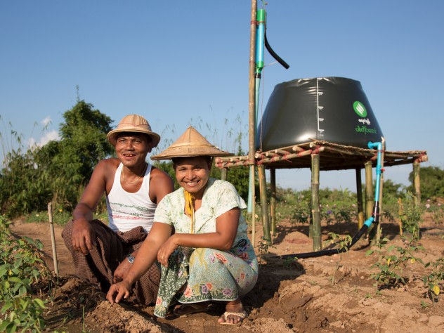 Proximity Designs' water basket in farm use: using a treadle pump, farmers can collect and move water and then distribute it by hose or drip irrigation lines—huge improvements in time and labor compared to bearing buckets of water on their shoulders with a wooden yoke.