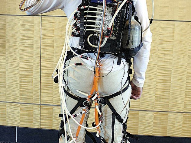 The actuator box, carried in the wearer's backpack, provides well-timed bursts of power that are transmitted to exosuit components strapped at the user's knee and ankle joints.