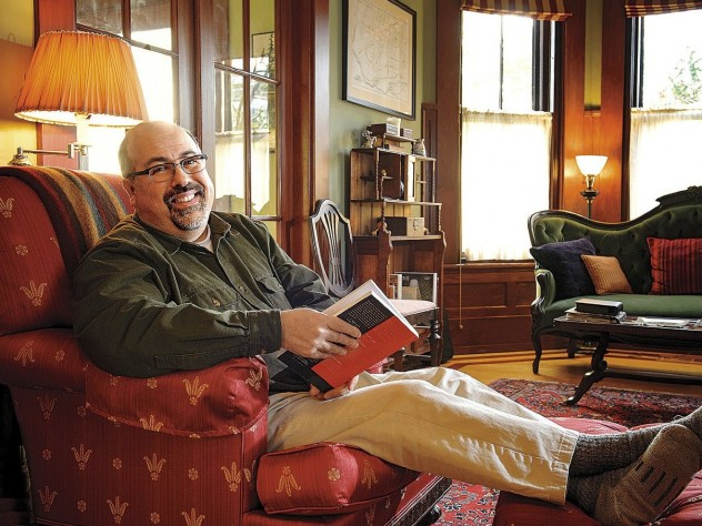 Poet and physician Rafael Campo relaxes at home with a book.