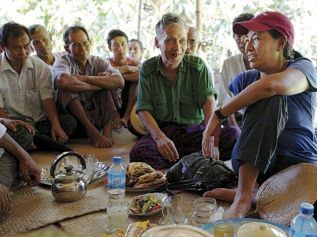 Debbie Taylor and residents of A Phaung Gyi and surrounding villages discuss credit, solar lights—and an alarming pest preying on the ripening rice crop.