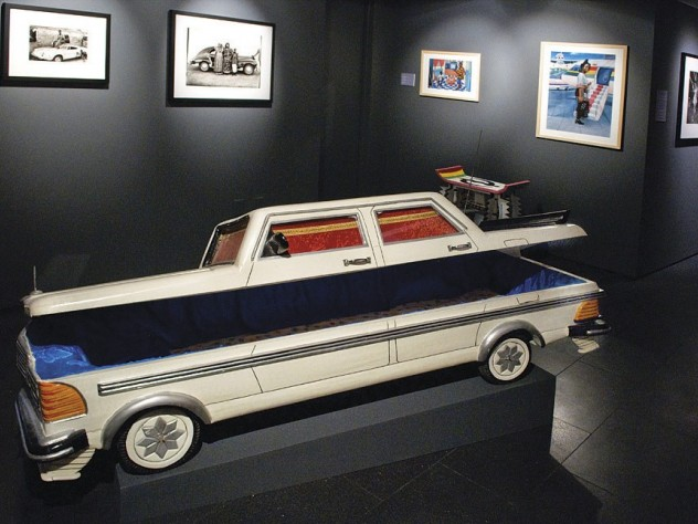 """A Mercedes-shaped """"fantasy coffin"""" by Samuel Kane Kwei reveals its blue fabric interior."""
