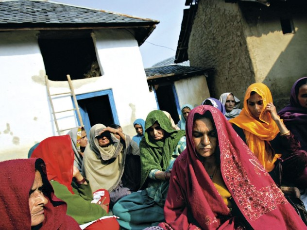 Vyasa Devi, foreground, mourning at the wake for her daughter, Meera, who died—by murder or suicide—in a marriage filled with physical abuse and demands for more dowry payments. Himachal Pradesh, December 2006.