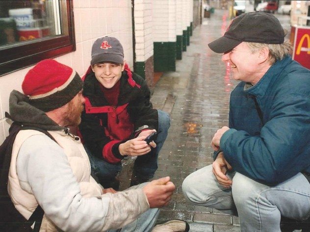 Even as BHCHP president, O'Connell spends time on the street. Here, he and physician assistant Jill Roncarati check on a homeless man.