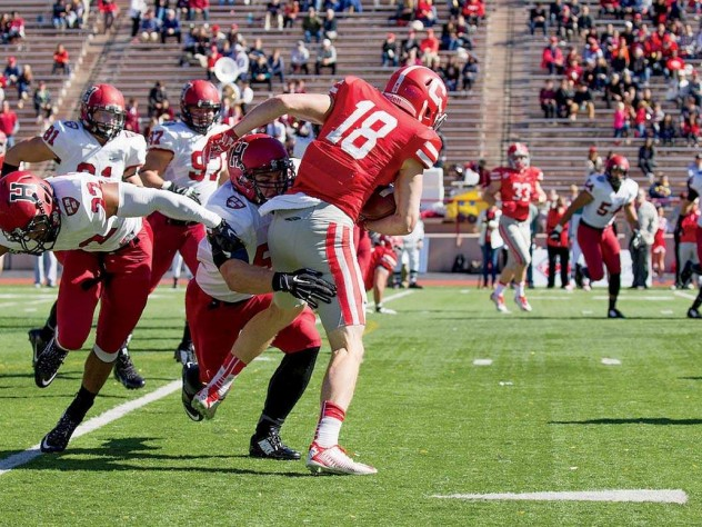 Senior linebacker Jake Lindsey (51) wrapped up Cornell receiver Ben Rogers after a nine-yard gain on this play. The Crimson limited the Big Red to 112 yards through the air in its 40-3 win.