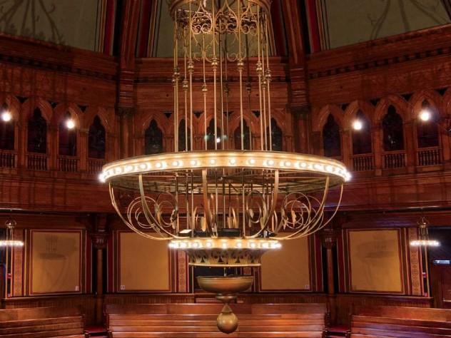 A grand chandelier at harvards sanders theatre harvard magazine the chandelier ablaze photograph by jim harrison aloadofball Images