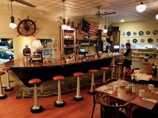 Photograph showing a restaurant bar made from a vintage dory