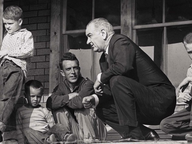 Historic photograph of President Lyndon Johnson meeting with impoverished Fletcher family in Kentucky in 1964