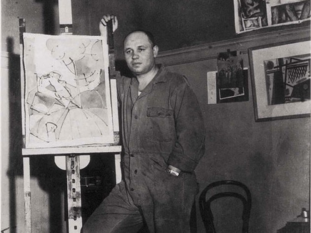Photograph of artist Romare Bearden standing by an easel c. 1940
