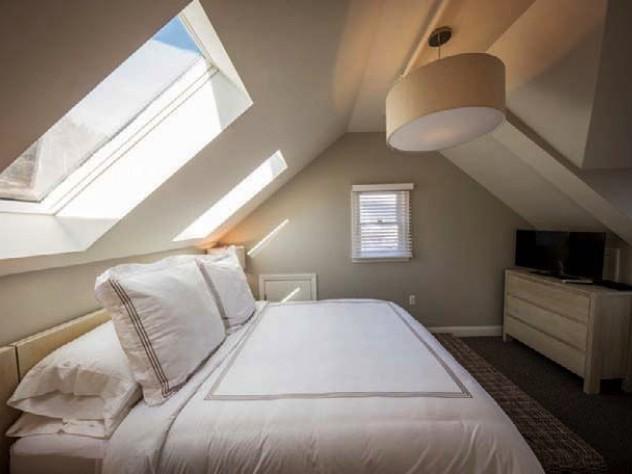 Sunlight flows into a Warfield House Inn bedroom