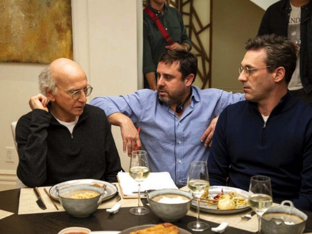 """Producer Jeff Schaffer sits between star Larry David (left) and another cast member on the """"Curb Your Enthusiasm"""" set."""