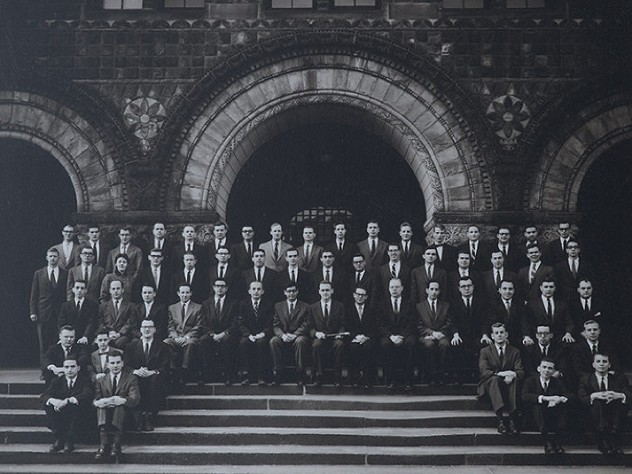 "Formal portrait of the Board of Editors for volume 70 of the ""Harvard Law Review"" (1956-1957), photographed on the steps of Austin Hall. The author, only the third woman admitted to Review membership, stands in the fourth row, at upper left."