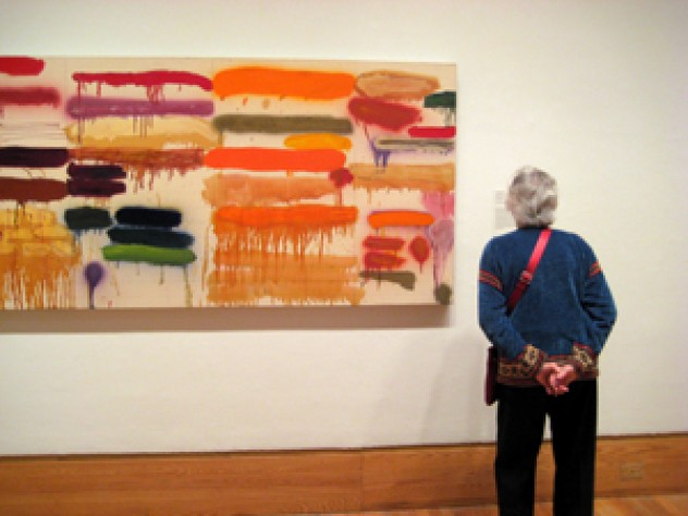 A guest ponders Joan Snyder's <em>Summer Orange</em>, 1970