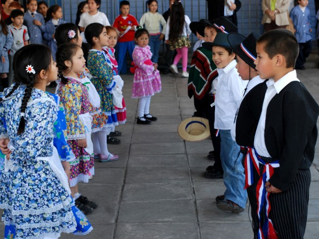 "Children perform ""cuecas,"" a Chilean traditional dance, for visitors including Harvard professors who helped design UBC."