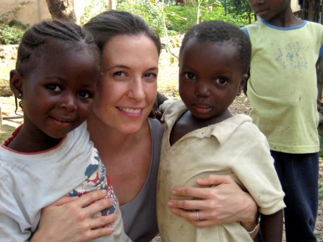 Theresa Betancourt with children in Sierra Leone