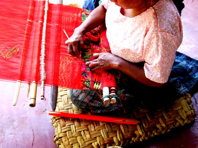 A weaver works on a traditional Mayan back strap loom in Guatemala in 2007.