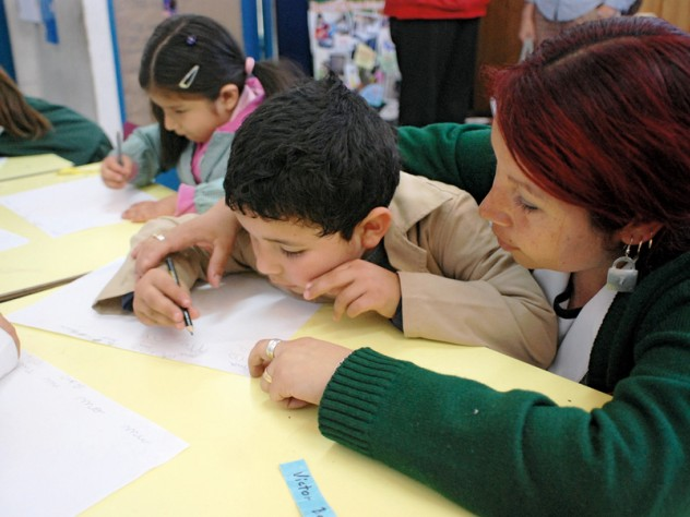 A teacher and student work together on a writing exercise. Chilean schools typically don't begin to teach reading until the first grade; UBC gives teachers strategies for introducing the alphabet and building early literacy with four- and five-year-olds.