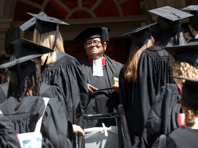 The Reverend Peter J. Gomes with graduating seniors outside the Memorial Church