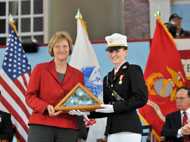 After her speech, President Faust received an American flag (previously flown over Harvard Yard and the ROTC unit's MIT headquarters) from U.S. Marine Corps cadet Shawna L. Sinnott on behalf of all the cadets.