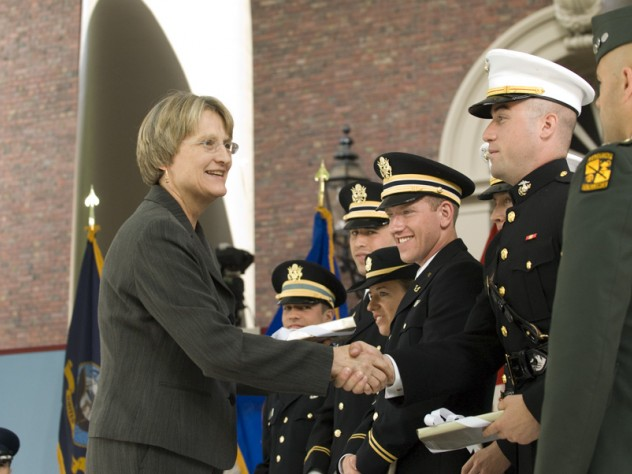 President Drew Faust presented each newly commissioned officer with a copy of <i>Just and Unjust Wars</i> by Michael Walzer.