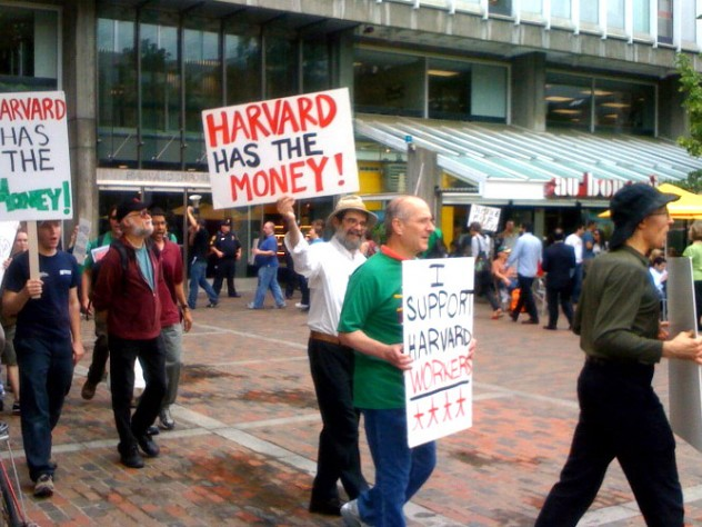 Students and workers protested layoffs on June 25, in a march that began in Harvard Yard and proceeded to Holyoke Center.