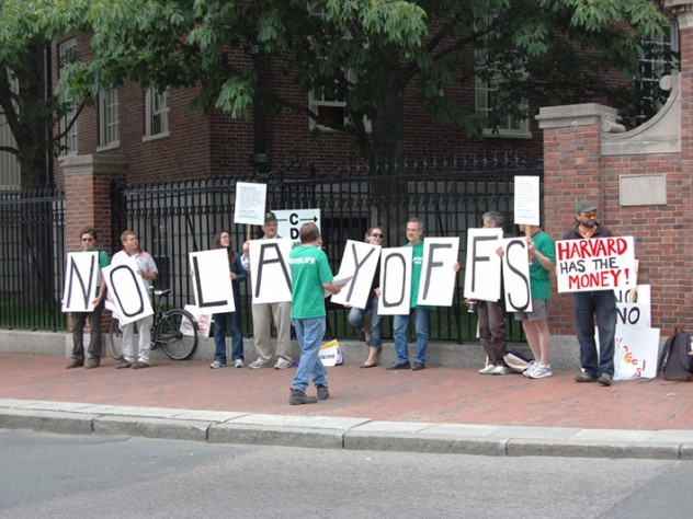 Union members from AFSCME protest potential layoffs at Harvard on Commencement day.
