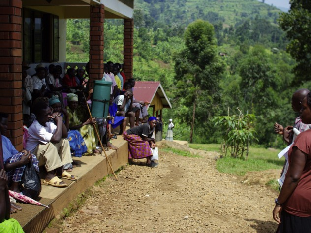 Patients waiting at the Beatrice Tierney Health Center listen to a lesson about malaria.