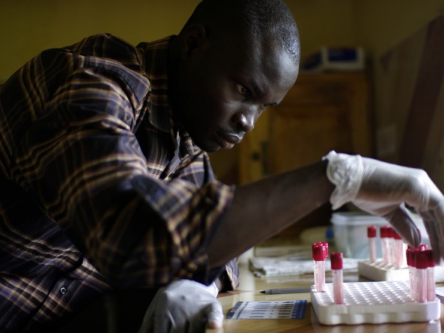 A clinic worker handles blood samples. This clinic offers something unusual for a rural clinic: a staff physician and free, rapid HIV testing each weekday.