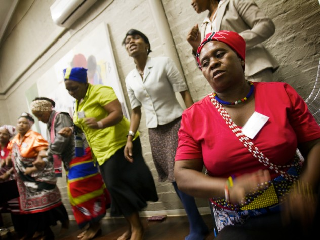 """At Edendale Hospital in Pietermaritzburg, South Africa, traditional healers perform a song before telling visitors about their work with iTeach. In the foreground is Makhosi Mbele. (<em>Makhosi</em> is the title used to refer to traditional healers, analogous to """"doctor."""")"""