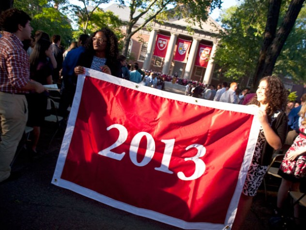 Seniors Kia J. McLeod (left) and Andrea R. Flores, vice president and president of the Undergraduate Council, display the banner that they presented to the class of 2013.