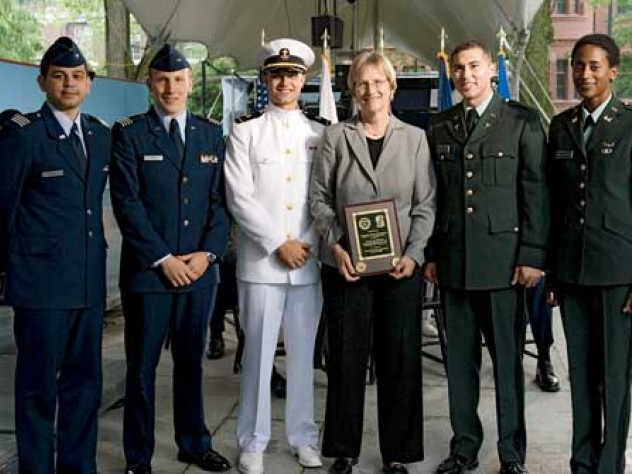 At the ROTC ceremony, from left to right: U.S. Air Force second lieutenants Roberto A. Guerra and Michael J. Arth, U.S. Navy ensign John D. Reed, President Faust, and U.S. Army second lieutenants Jason M. Scherer and J. Danielle Williams.